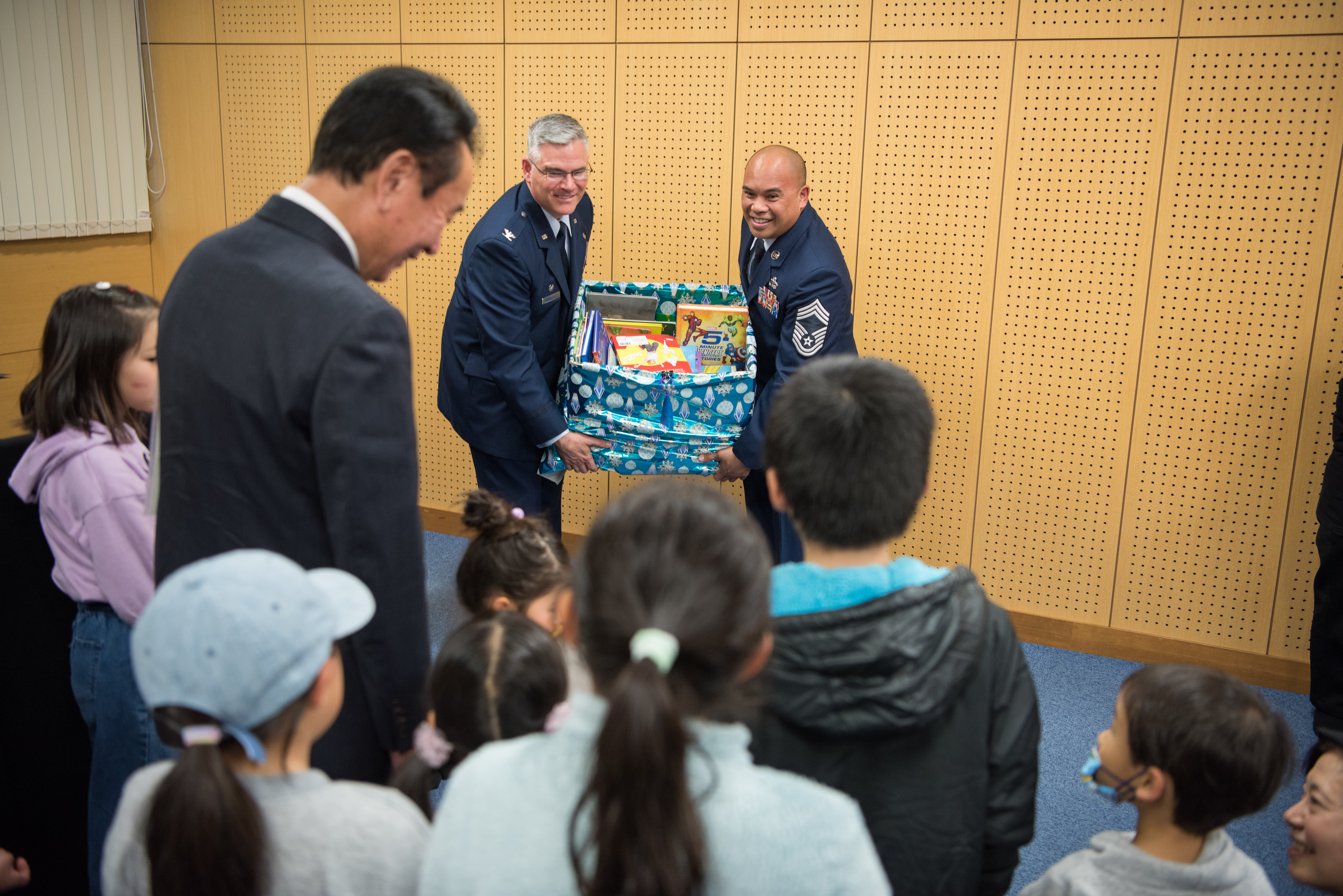 374th MXG donates books to local library