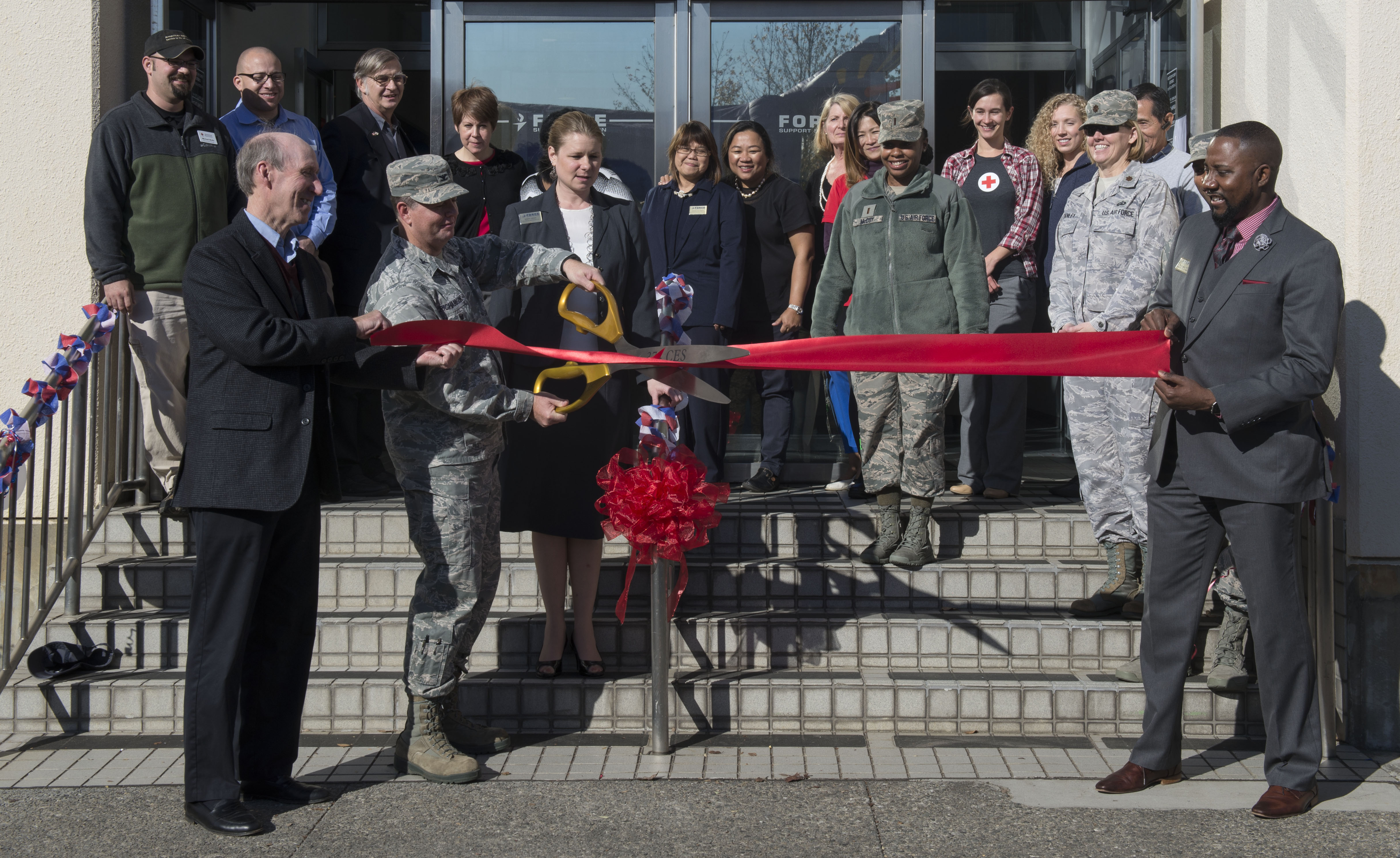 Airman cut the ribbon signaling the open of the Airman & Family Readiness Center